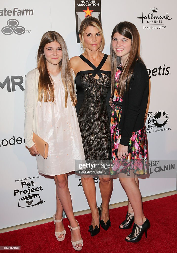 Actress <a gi-track='captionPersonalityLinkClicked' href=/galleries/search?phrase=Lori+Loughlin&family=editorial&specificpeople=208147 ng-click='$event.stopPropagation()'>Lori Loughlin</a> (C) attends the 3rd annual American Humane Association Hero Dog Awards at The Beverly Hilton Hotel on October 5, 2013 in Beverly Hills, California.