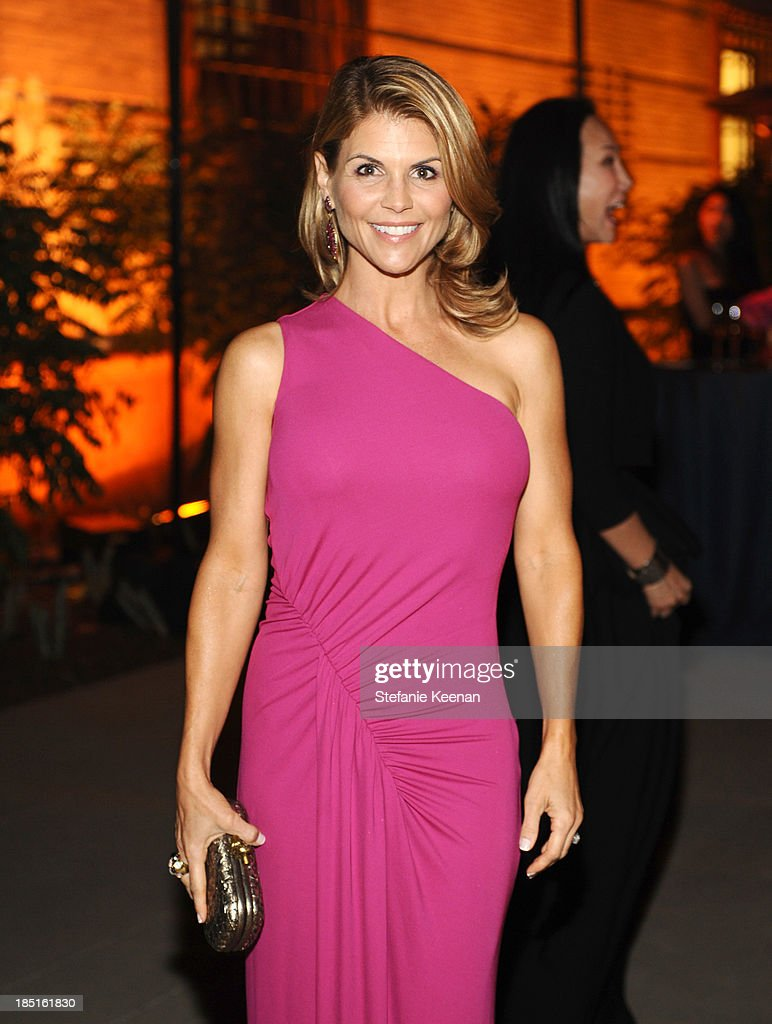 Actress Lori Loughlin attends the Wallis Annenberg Center for the Performing Arts Inaugural Gala presented by Salvatore Ferragamo at the Wallis Annenberg Center for the Performing Arts on October 17, 2013 in Beverly Hills, California.