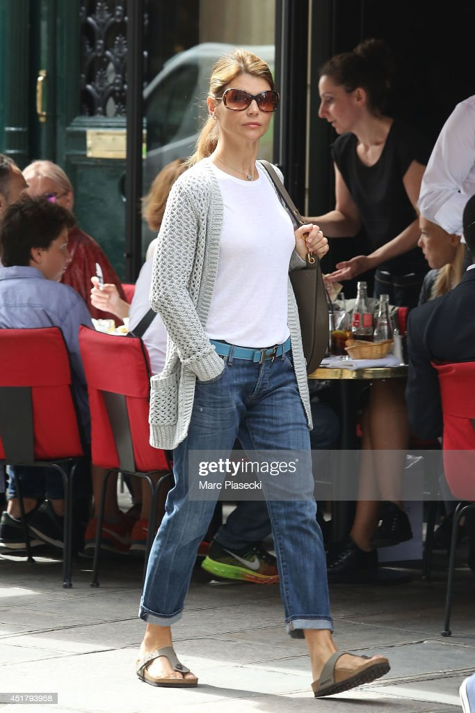 Actress <a gi-track='captionPersonalityLinkClicked' href=/galleries/search?phrase=Lori+Loughlin&family=editorial&specificpeople=208147 ng-click='$event.stopPropagation()'>Lori Loughlin</a> is seen strolling on 'Rue du Faubourg Saint Honore' on July 7, 2014 in Paris, France.