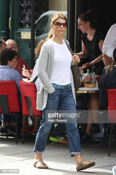 Actress Lori Loughlin is seen strolling on 'Rue du Faubourg Saint Honore' on July 7 2014 in Paris France