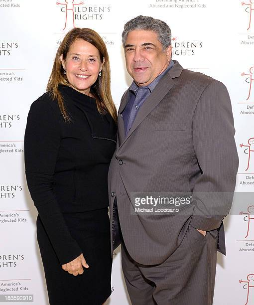 Actress Lorraine Bracco and actor Vincent Pastore attend 8th Annual Children's Rights Benefit at Four Seasons Restaurant New York on October 7 2013...