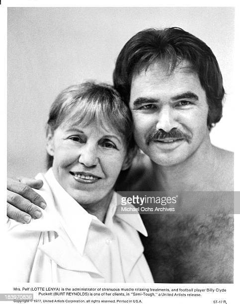 Actress Lotte Lenya and actor Burt Reynolds pose for the United Artists movie ' SemiTough' in 1977