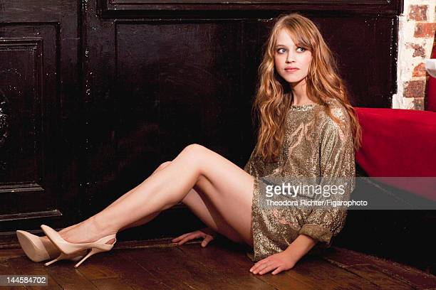 Actress Lou de Laage poses for Madame Figaro on March 30 2012 in Paris France PUBLISHED IMAGE Figaro ID 103703005 Dress by Valentino shoes by...