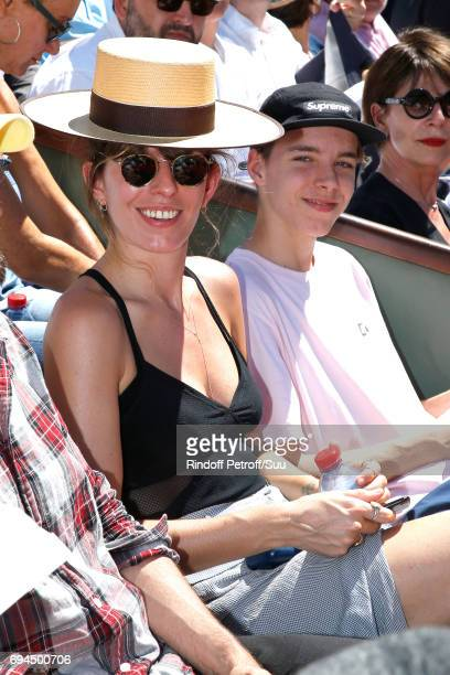 Actress Lou Doillon and her son Marlowe Jack Tiger Mitchell attend the Women Final of the 2017 French Tennis Open Day Fourteen at Roland Garros on...