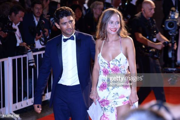 Actress Lou Luttiau and actor Salim Kechiouche attend the premiere of the movie 'Mektoub My Love Canto Uno' presented in competition at the 74th...
