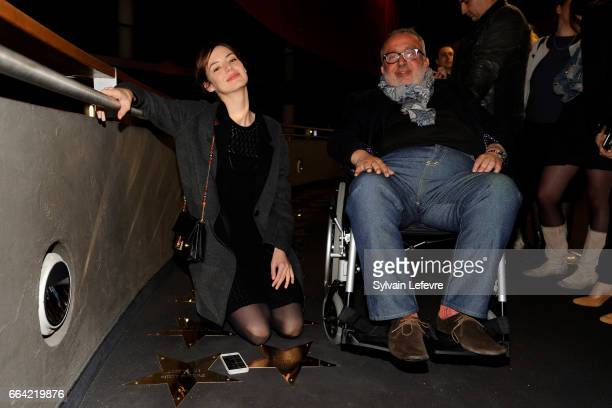Actress Louise Bourgoin and director Dominique Farrugia pose near the stars to their name before 'Sous Le Meme Toit' Premiere at Kinepolis on April 3...