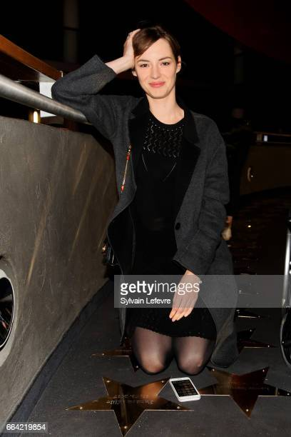 Actress Louise Bourgoin poses next to the star in her name before 'Sous Le Meme Toit' Premiere at Kinepolis on April 3 2017 in Lille France