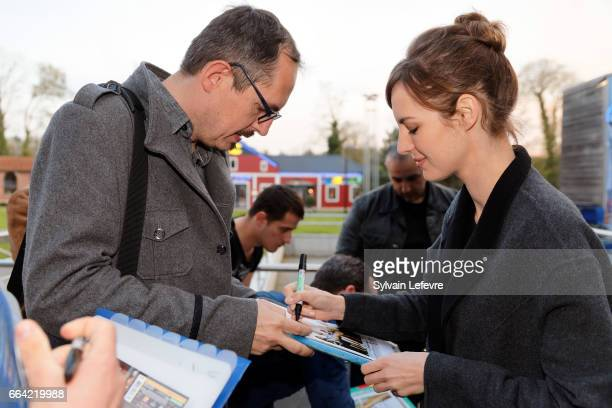 Actress Louise Bourgoin signs autographs before 'Sous Le Meme Toit' Premiere at Kinepolis on April 3 2017 in Lille France