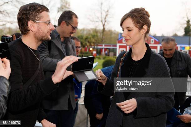 Actress Louise Bourgoin takes selfies with fans before 'Sous Le Meme Toit' Premiere at Kinepolis on April 3 2017 in Lille France