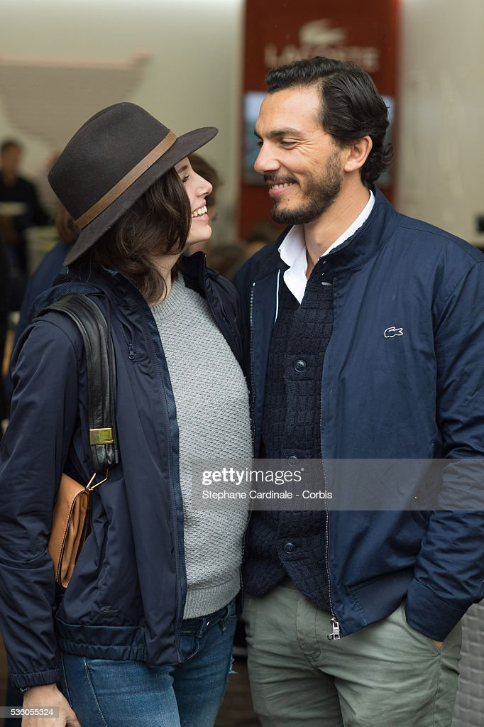 Actress Louise Monot and her companion actor Samir Boitar attends day ten of the 2016 French Open at Roland Garros on May 31, 2016 in Paris, France.
