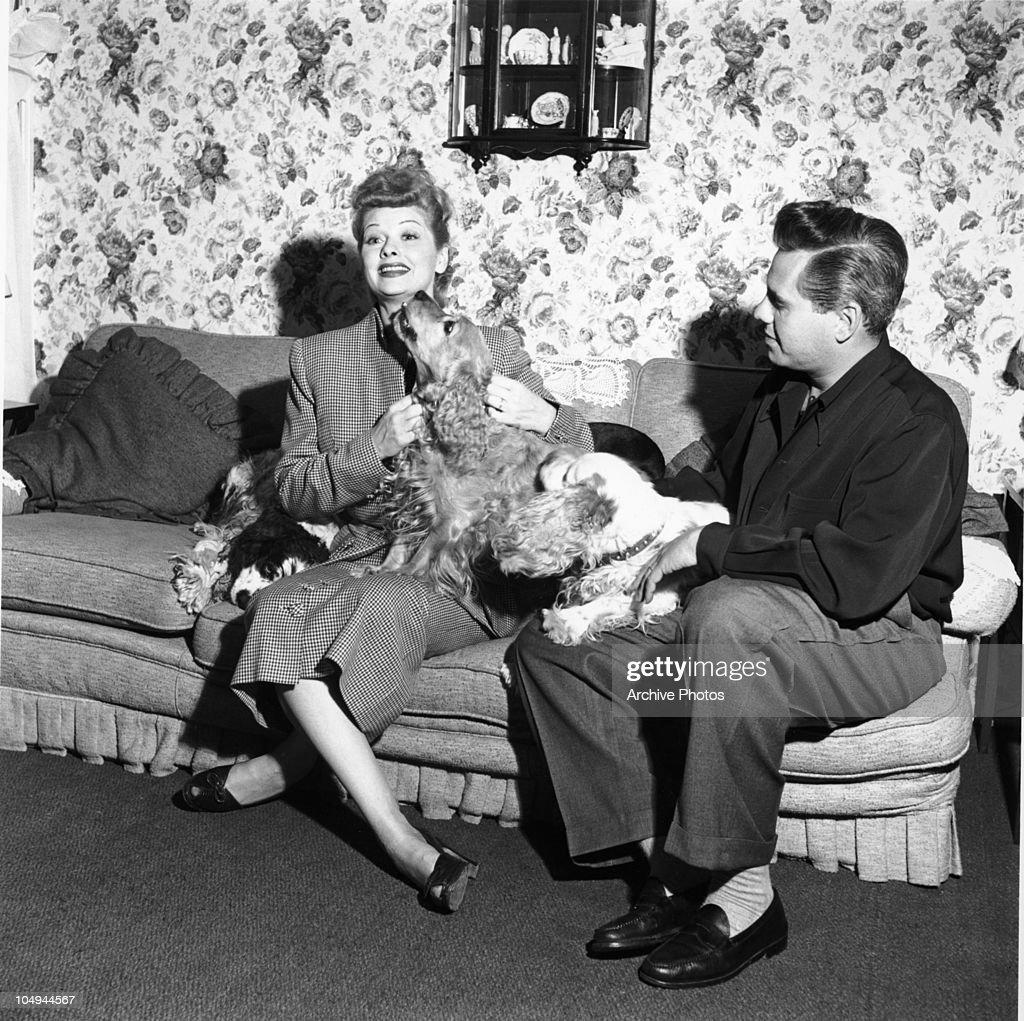 Actress <a gi-track='captionPersonalityLinkClicked' href=/galleries/search?phrase=Lucille+Ball&family=editorial&specificpeople=70020 ng-click='$event.stopPropagation()'>Lucille Ball</a> and her husband actor <a gi-track='captionPersonalityLinkClicked' href=/galleries/search?phrase=Desi+Arnaz+-+Born+1917&family=editorial&specificpeople=206778 ng-click='$event.stopPropagation()'>Desi Arnaz</a> sit on the sofa with their three Cocker Spaniel dogs circa 1950's.