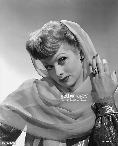 Actress Lucille Ball for MGM Pictures in a promotional shot wearing a head scarf 1942