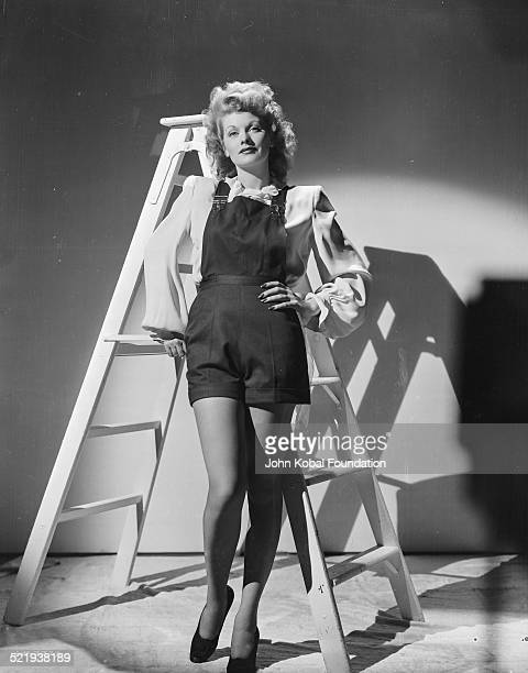 Actress Lucille Ball for MGM Pictures wearing dungarees in a promotional shot for the movie 'Meet the People' 1943