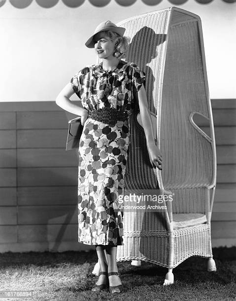 Actress Lucille Ball popular RKO Radio Pictures player models the latest in printed linen for spring fashions Hollywood California 1936