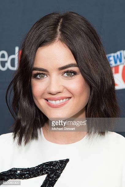 Actress Lucy Hale poses in the press room for the 'Pretty Little Liars' panel during New York ComicCon Day 2 at The Jacob K Javits Convention Center...