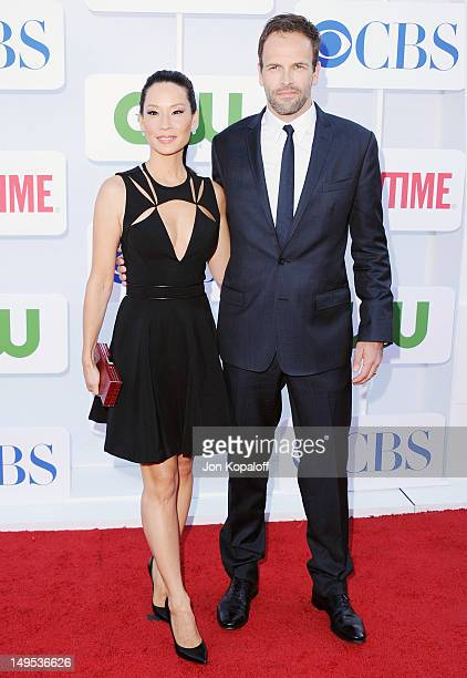Actress Lucy Liu and actor Jonny Lee Miller arrive at the 2012 CBS Showtime and The CW TCA Summer Party at 9900 Wilshire Blvd on July 29 2012 in...