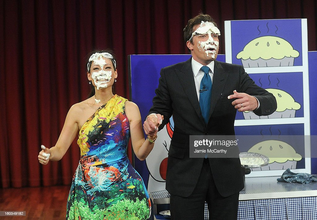 Actress Lucy Liu and host Jimmy Fallon play Rock Paper Scissors and Pie on 'Late Night With Jimmy Fallon' at Rockefeller Center on January 29, 2013 in New York City.