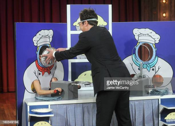 Actress Lucy Liu and host Jimmy Fallon play Rock Paper Scissors and Pie on 'Late Night With Jimmy Fallon' at Rockefeller Center on January 29 2013 in...