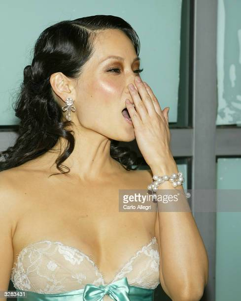 Actress Lucy Liu attends the Miramax Feature film premiere of 'Kill Bill Vol II' at the Arclight's Cinerama Dome April 8 2004 in Hollywood California