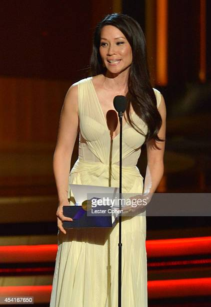 Actress Lucy Liu speaks onstage at the 66th Annual Primetime Emmy Awards held at Nokia Theatre LA Live on August 25 2014 in Los Angeles California