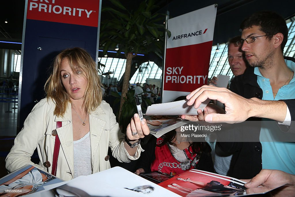 Actress Ludivine Sagnier signs autographs as she is sighted at Nice airport after the 66th Annual Cannes Film Festival on May 27, 2013 in Nice, France.