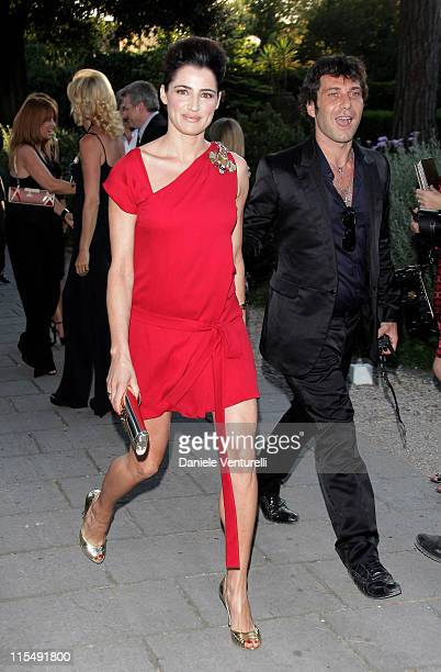 Actress Luisa Ranieri and an unidentified guest attend Gucci Fashion Show and Party held at Villa Aurelia on July 8 2008 in Rome Italy