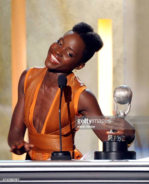 Actress Lupita Nyong'o accepts the award for Outstanding Actress in a Motion Picture for '12 Years a Slave' onstage during the 45th NAACP Image...