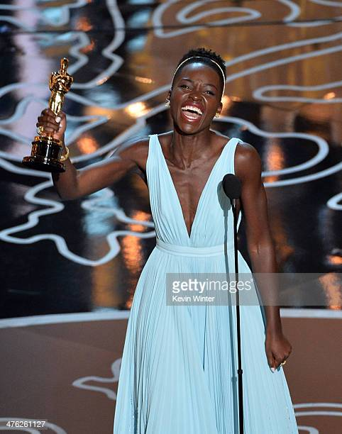 Actress Lupita Nyong'o accepts the Best Performance by an Actress in a Supporting Role award for '12 Years a Slave' onstage during the Oscars at the...