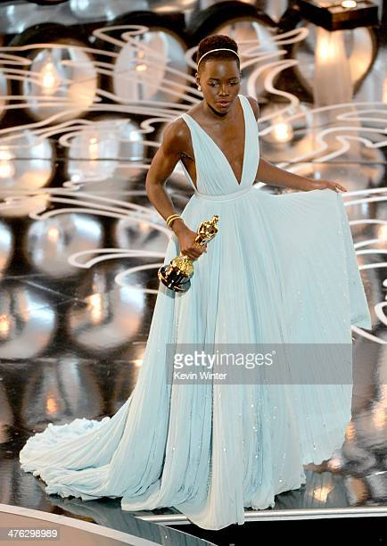 Actress Lupita Nyong'o accepts the Best Picture award for '12 Years a Slave' onstage during the Oscars at the Dolby Theatre on March 2 2014 in...