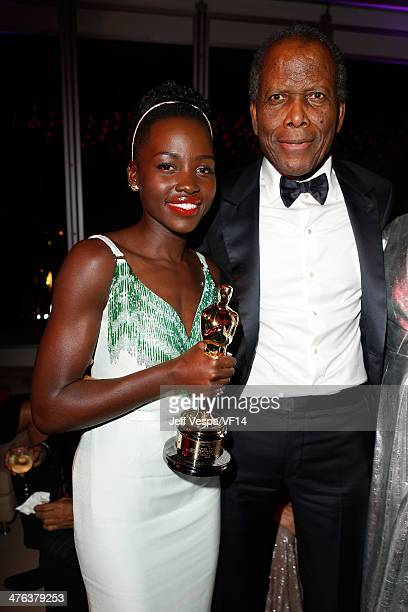 Actress Lupita Nyong'o and actor Sidney Poitier attend the 2014 Vanity Fair Oscar Party Hosted By Graydon Carter on March 2 2014 in West Hollywood...