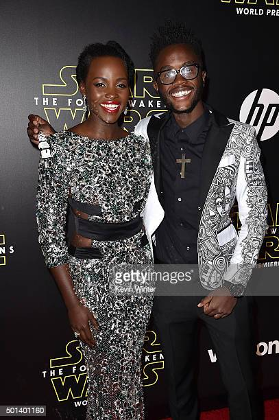 Actress Lupita Nyong'o and Peter Nyong'o attend the World Premiere of 'Star Wars The Force Awakens' at the Dolby El Capitan and TCL Theatres on...