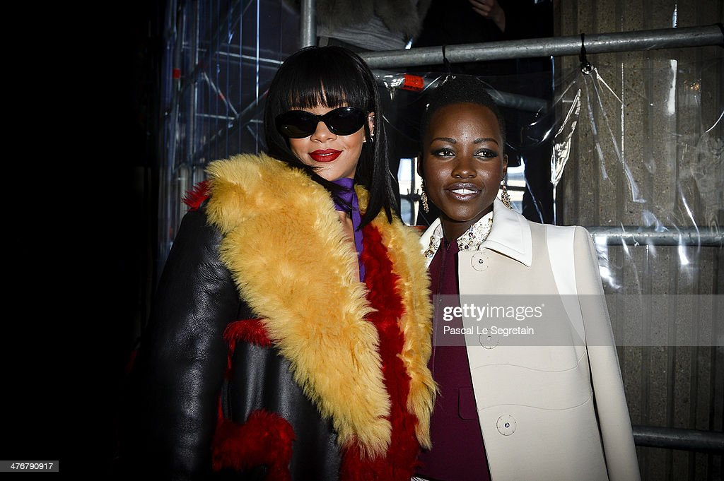 Actress Lupita Nyong'o and singer Rihanna attend the Miu Miu show as part of the Paris Fashion Week Womenswear Fall/Winter 2014-2015 on March 5, 2014 in Paris, France.