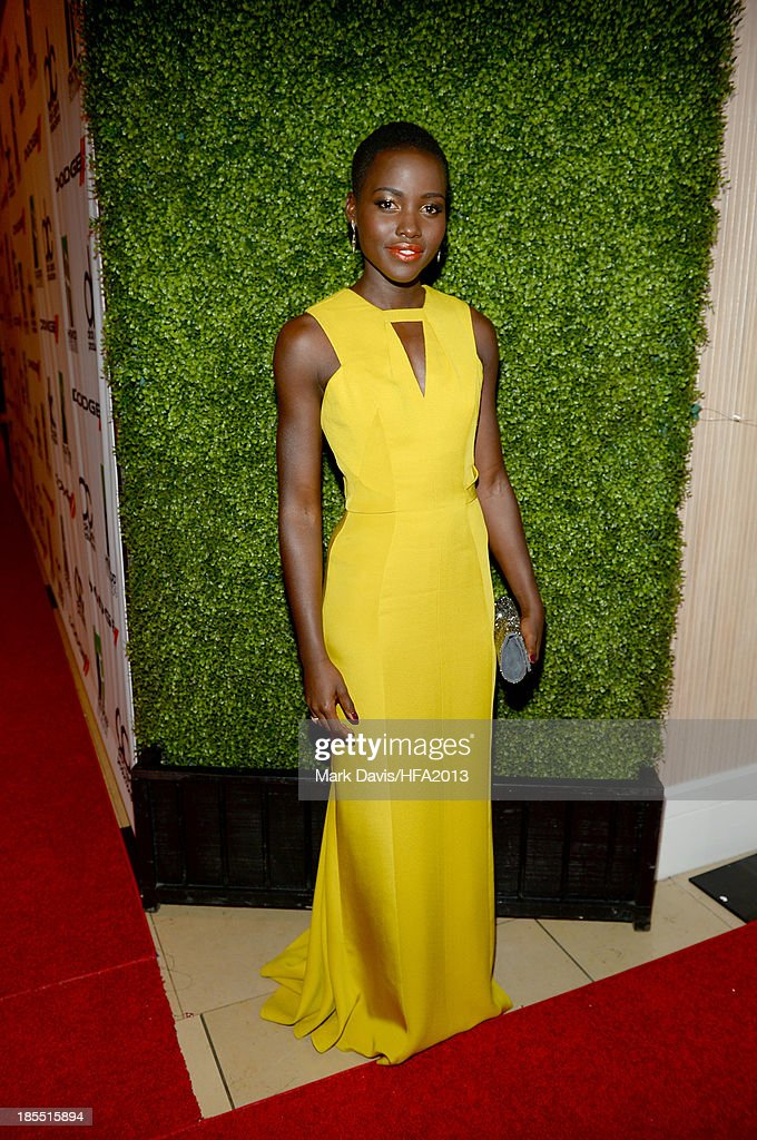 Actress <a gi-track='captionPersonalityLinkClicked' href=/galleries/search?phrase=Lupita+Nyong%27o&family=editorial&specificpeople=10961876 ng-click='$event.stopPropagation()'>Lupita Nyong'o</a> arrives at the 17th annual Hollywood Film Awards at The Beverly Hilton Hotel on October 21, 2013 in Beverly Hills, California.