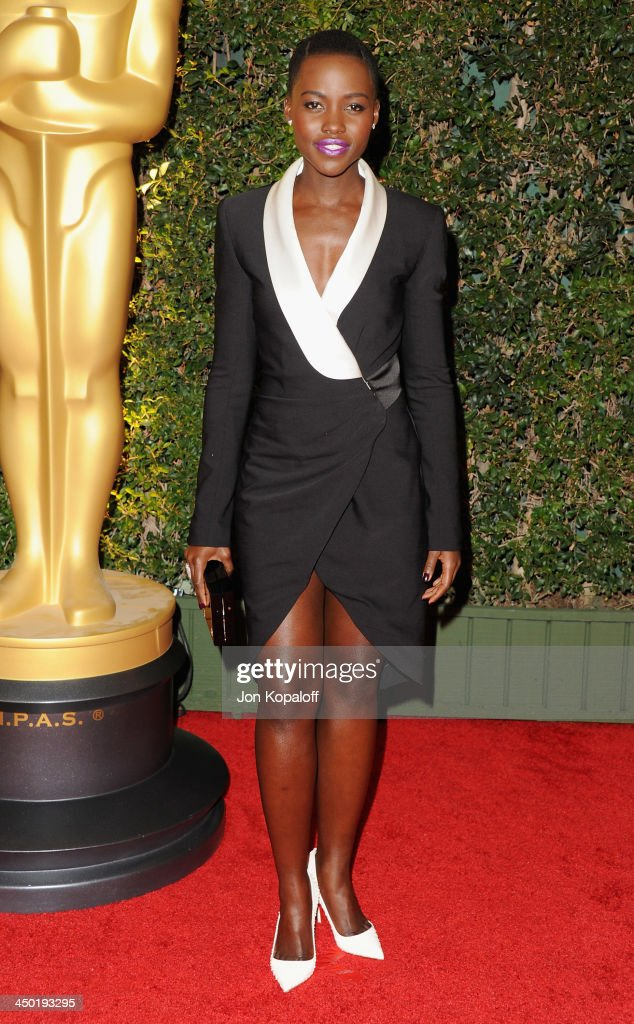 Actress <a gi-track='captionPersonalityLinkClicked' href=/galleries/search?phrase=Lupita+Nyong%27o&family=editorial&specificpeople=10961876 ng-click='$event.stopPropagation()'>Lupita Nyong'o</a> arrives at The Board Of Governors Of The Academy Of Motion Picture Arts And Sciences' Governor Awards at Dolby Theatre on November 16, 2013 in Hollywood, California.