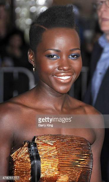 Actress Lupita Nyong'o arrives at the Los Angeles Premiere 'NonStop' on February 24 2014 at Regency Village Theatre in Westwood California