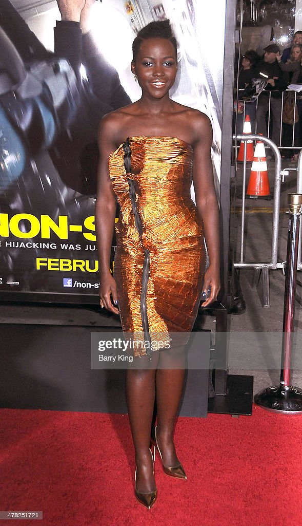 Actress Lupita Nyong'o arrives at the Los Angeles Premiere 'Non-Stop' on February 24, 2014 at Regency Village Theatre in Westwood, California.