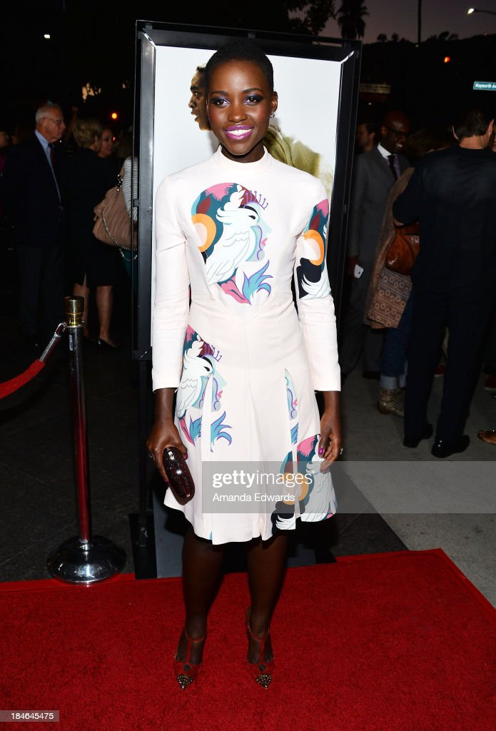 Actress <a gi-track='captionPersonalityLinkClicked' href=/galleries/search?phrase=Lupita+Nyong%27o&family=editorial&specificpeople=10961876 ng-click='$event.stopPropagation()'>Lupita Nyong'o</a> arrives at the Los Angeles premiere of '12 Years A Slave' at Directors Guild Of America on October 14, 2013 in Los Angeles, California.