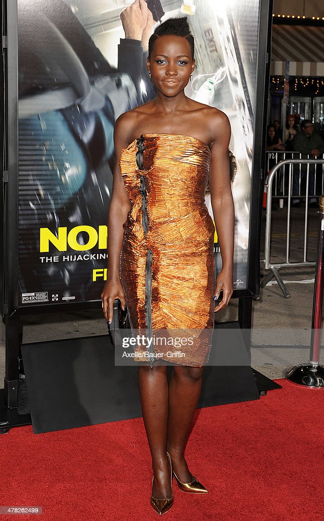 Actress <a gi-track='captionPersonalityLinkClicked' href=/galleries/search?phrase=Lupita+Nyong%27o&family=editorial&specificpeople=10961876 ng-click='$event.stopPropagation()'>Lupita Nyong'o</a> arrives at the Los Angeles premiere of 'Non-Stop' at Regency Village Theatre on February 24, 2014 in Westwood, California.