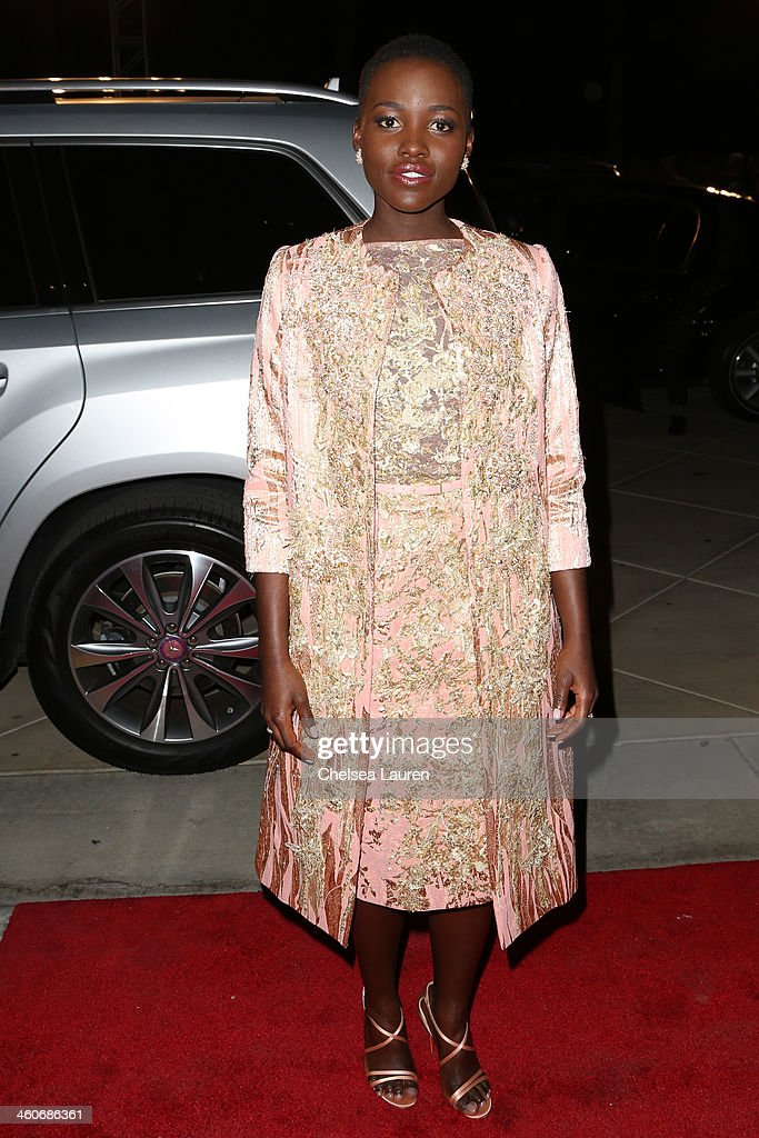 Actress <a gi-track='captionPersonalityLinkClicked' href=/galleries/search?phrase=Lupita+Nyong%27o&family=editorial&specificpeople=10961876 ng-click='$event.stopPropagation()'>Lupita Nyong'o</a> arrives in style during the Mercedes-Benz arrivals at the 25th Annual Palm Springs International Film Festival Awards Gala onJanuary 4, 2014 in Palm Springs, California.