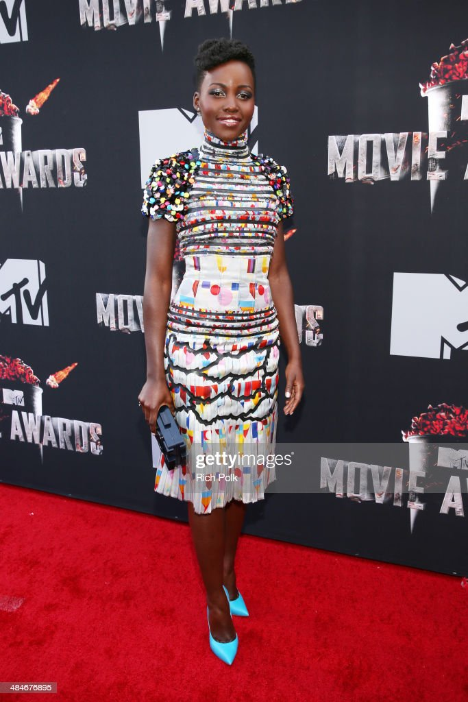 Actress <a gi-track='captionPersonalityLinkClicked' href=/galleries/search?phrase=Lupita+Nyong%27o&family=editorial&specificpeople=10961876 ng-click='$event.stopPropagation()'>Lupita Nyong'o</a> attends the 2014 MTV Movie Awards at Nokia Theatre L.A. Live on April 13, 2014 in Los Angeles, California.