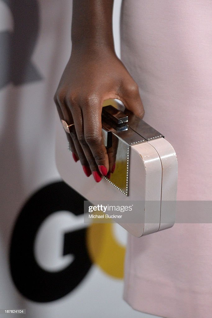 Actress Lupita Nyong'o (purse detail) attends the GQ Men Of The Year Party at The Ebell Club of Los Angeles on November 12, 2013 in Los Angeles, California.