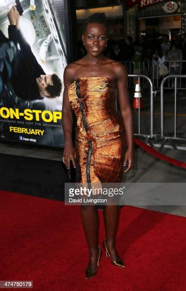 Actress Lupita Nyong'o attends the premiere of Universal Pictures and Studiocanal's 'NonStop' at the Regency Village Theatre on February 24 2014 in...