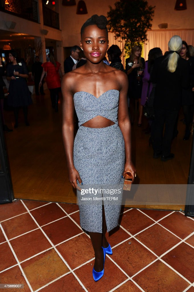 Actress <a gi-track='captionPersonalityLinkClicked' href=/galleries/search?phrase=Lupita+Nyong%27o&family=editorial&specificpeople=10961876 ng-click='$event.stopPropagation()'>Lupita Nyong'o</a> attends the Women In Film Pre-Oscar Cocktail Party presented by Perrier-Jouet, MAC Cosmetics & MaxMara at Fig & Olive Melrose Place on February 28, 2014 in West Hollywood, California.