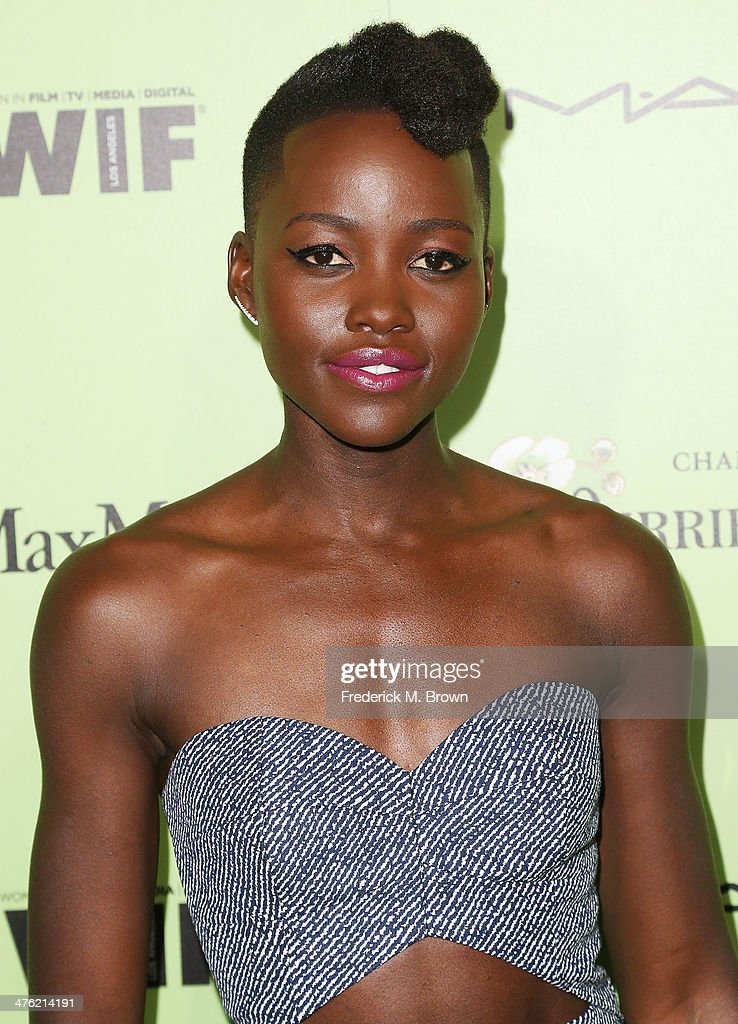 Actress <a gi-track='captionPersonalityLinkClicked' href=/galleries/search?phrase=Lupita+Nyong%27o&family=editorial&specificpeople=10961876 ng-click='$event.stopPropagation()'>Lupita Nyong'o</a> attends the Women in Film Pre-Oscar Cocktail Party Presented by Perrier-Jouet, MAC & MaxMara at the Fig & Olive Melrose Place on February 28, 2014 in West Hollywood, California.