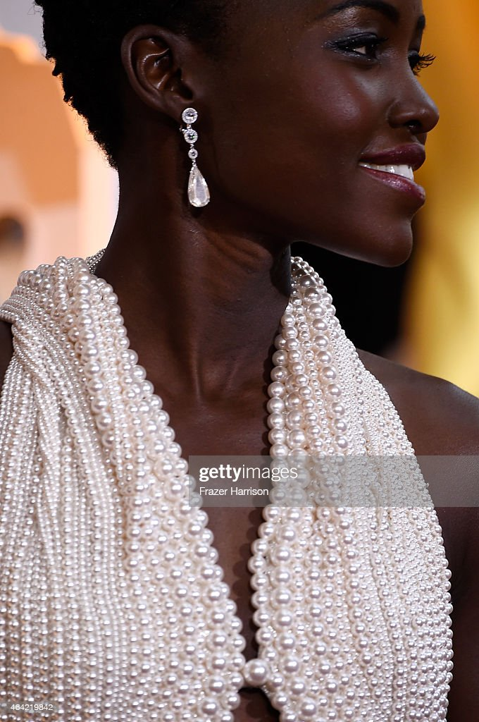 Actress Lupita Nyong'o, fashion detail, attends the 87th Annual Academy Awards at Hollywood & Highland Center on February 22, 2015 in Hollywood, California.
