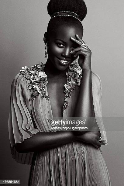 Actress Lupita Nyong'o is photographed for Madame Figaro on May 18 2015 at the Cannes Film Festival in Cannes France Dress headband ring earrings and...
