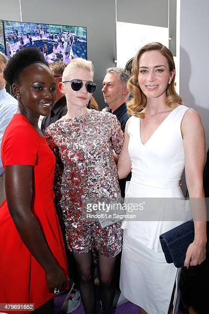 Actress Lupita Nyong'o Musician Grimes and Actress Emily Blunt pose Backstage after the Christian Dior show as part of Paris Fashion Week Haute...