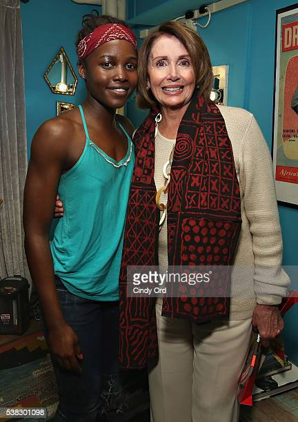 Actress Lupita Nyong'o poses for a photo backstage at Broadway's 'Eclipsed' with Minority Leader of the United States House of Representatives Nancy...