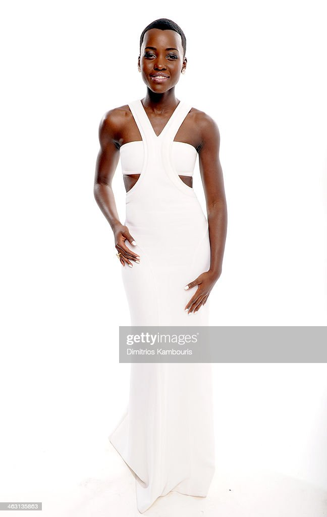 Actress <a gi-track='captionPersonalityLinkClicked' href=/galleries/search?phrase=Lupita+Nyong%27o&family=editorial&specificpeople=10961876 ng-click='$event.stopPropagation()'>Lupita Nyong'o</a> poses for a portrait during the 19th Annual Critics' Choice Movie Awards at Barker Hangar on January 16, 2014 in Santa Monica, California.