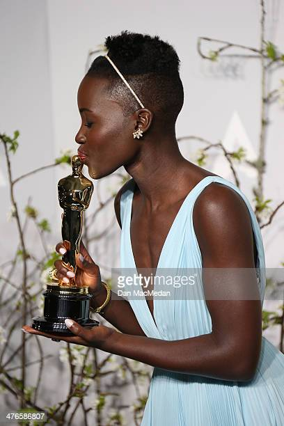 Actress Lupita Nyong'o poses in the press room at the 86th Annual Academy Awards at Hollywood Highland Center on March 2 2014 in Los Angeles...